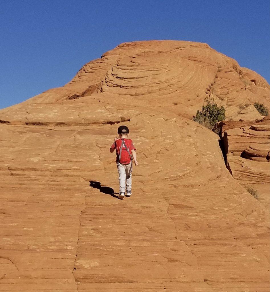 Boy walking up Petrified Dune